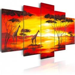Obraz Żyrafy na tle zachodzącego słońca
